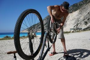 putting bike together on Myrtos beach